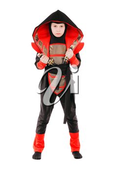 Little boy wearing ninja costume and posing with swords. Isolated on white