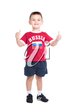 Nice little boy posing in Russian football uniform. Isolated on white