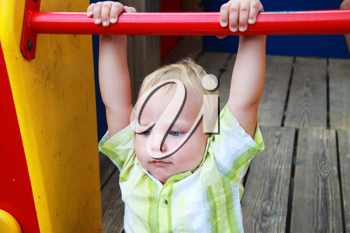 Royalty Free Photo of a Little Boy Playing at a Playground