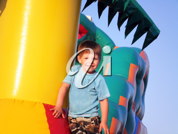 Royalty Free Photo of a Boy Playing on an Inflatable Castle