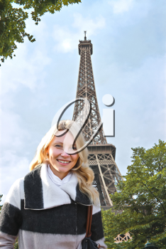Autumn in Paris. Girl on the background of the Eiffel Tower