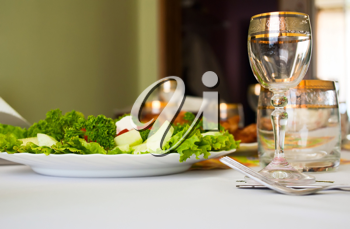 Royalty Free Photo of a Salad and Glass of Wine
