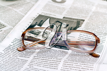 Royalty Free Photo of Reading Glasses on a Newspaper