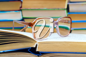 Royalty Free Photo of Reading Glasses on a Stack of Books