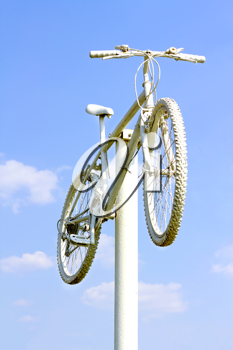 Royalty Free Photo of a Bicycle on a Pole