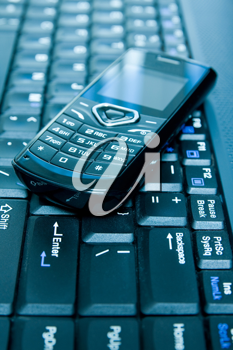 Royalty Free Photo of a Cellphone on a Laptop