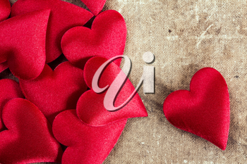 Decorative hearts pile on old canvas background