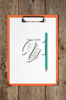 Clipboard with pencil and  list of resolutions for new year