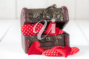 Open wooden box with a cute little hearts inside.