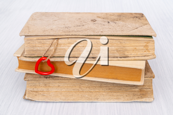 Old books with red heart on the string. Book love concept.Valentine's day concept.