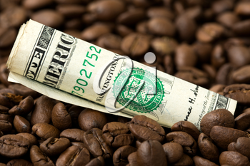 USA coffee market. Roasted coffee beans and USD currency close-up