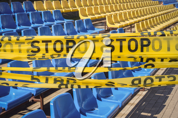 Protective stop tape prevents spectators from entering stadium during competition without spectators during COVID-19 epidemic.