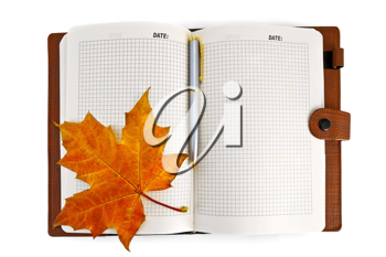 Opened notebook with a red maple leaf isolated on white background