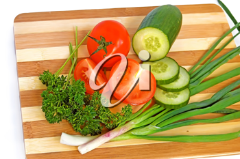 Tomato, cucumber, parsley, green onion on a wooden board on a white background