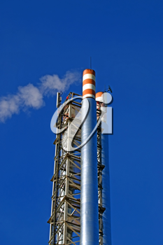 Pipes, gas boiler-house with a withdrawing smoke against the blue sky