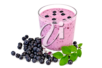 The glass of milkshake and blueberries, berries and green sprig of blueberries isolated on white background
