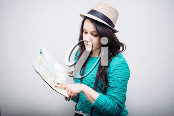 Girl in a hat and travel maps