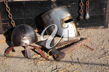 Antic helmets, chains and axe.