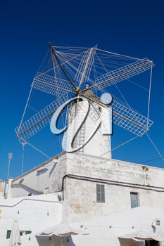 The Moli des comte (Count's Mill) in Ciutadella, Menorca, Spain. This corn wind mill was built in 1762 and was preserved in fine state  to this day.