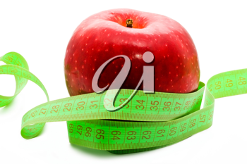 Royalty Free Photo of a Measuring Tape and Apple