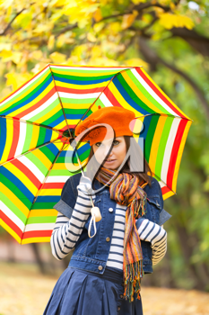 Royalty Free Photo of a Woman Holding an Umbrella
