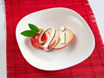 Royalty Free Photo of an Apple on a Plate