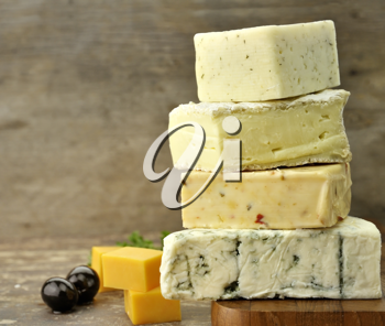 Royalty Free Photo of an Assortment of Cheese On a Cutting Board