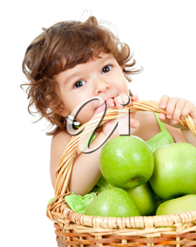 Royalty Free Photo of a Little Girl in a Basket With Apples