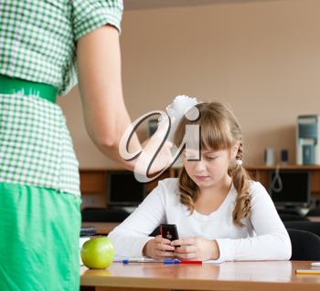 Royalty Free Photo of a Teaching Discipling a Student for Using a Cellphone