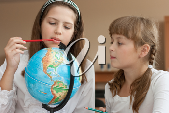 Royalty Free Photo of Two Students Looking at a Globe