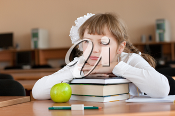 Royalty Free Photo of a Schoolgirl at Her Desk