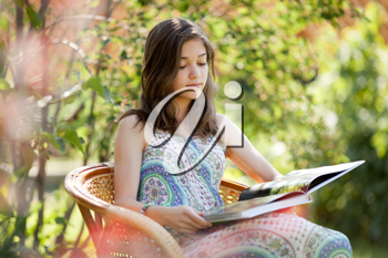 Royalty Free Photo of a Girl Reading Outside