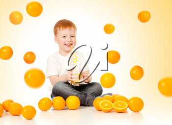 Royalty Free Photo of a Little Boy Drinking Juice