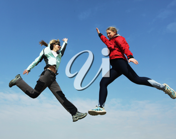 Royalty Free Photo of Girls Jumping
