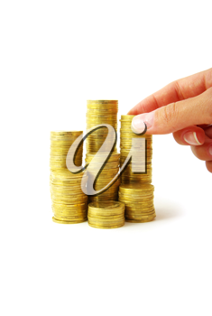 Royalty Free Photo of a Person Stacking Coins