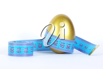 Royalty Free Photo of a Gold Egg With Measuring Tape