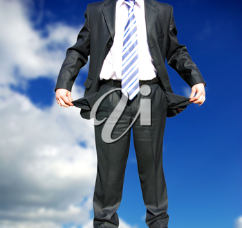 Royalty Free Photo of a Businessman With Empty Pockets
