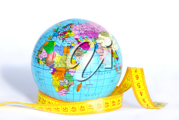 Measuring tape stretched across globe on white