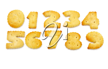 Yellow cookies in the form of figures on a white background