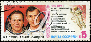USSR - CIRCA 1984: stamp printed in USSR, shows Spacecraft complex Salyut-7 and Soyuz T-9, portraits of cosmonauts V.A Lyahov and A.P.Aleksandrov 150-day flight of Cosmos, circa 1984