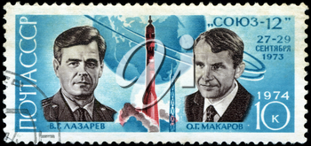 USSR - CIRCA 1974: A Stamp printed in USSR shows the cosmonauts V.G. Lazarev and O.G. Makarov, and Soyuz 12, series, circa 1974