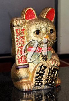 Royalty Free Photo of a Golden Welcome Cat Figurine