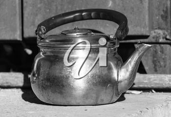 photography still life old kettle placed on a wooden floor.