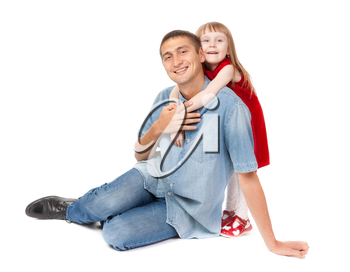 Smiling father and young daughter sitting on the floor. Isolated on white background