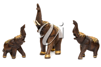 Three wooden statues of elephants, isolate on white