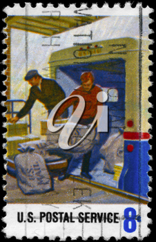 Royalty Free Photo of 1973 US Stamp Shows the Loading Mail on Truck, Postal Service Employees