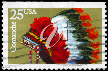 Royalty Free Photo of 1990 US Stamps Shows the Indian Headdresses of the Tribe Comanche