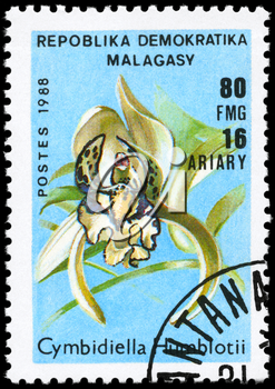 MALAGASY REPUBLIC - CIRCA 1988: A Stamp printed in MALAGASY REPUBLIC shows image of a Cymbidiella humblotii, from the series Orchids, circa 1988
