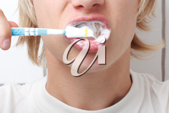 Royalty Free Photo of a Person Brushing Their Teeth