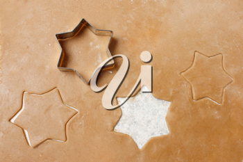 Royalty Free Photo of a Cookie Cutter on Cookie Dough